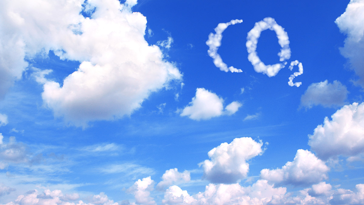 Carbon dioxide CO2 symbol in cloudy sky