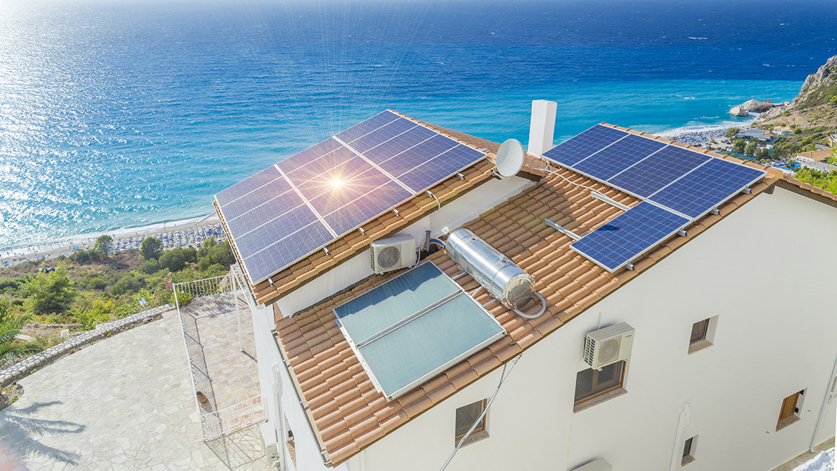 Solar panels on the roof of a building near the sea