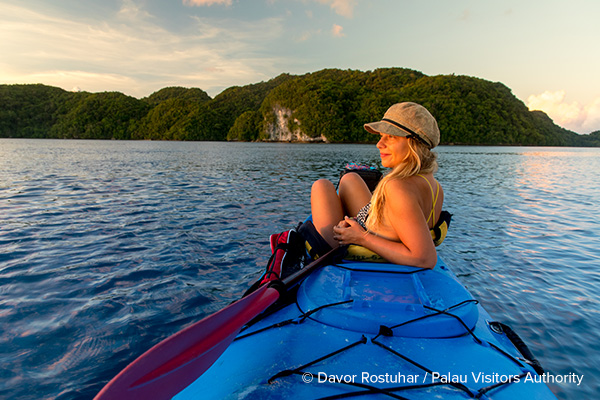 Woman kayaking in Palau